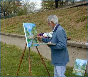 El artista argentino Jorge Cruz Crinejo mientras plasma en acuarela un paisaje de su entorno, la ciudad de Córdoba