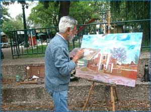 El pintor argentino Jorge Crus Crinejo realizando una de sus obras en óleo en la ciudad de Cördoba, donde nació